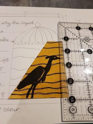Bird appique tried against paper design